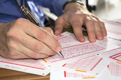 Man play lottery Royalty Free Stock Photos