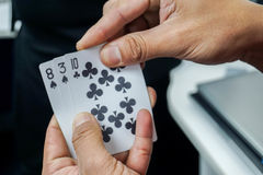 Man play poker card in hands for gambling. Close up man play poker card in hands for gambling stock photography