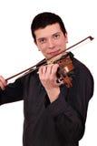 Man play violin. Young man play violin studio shot Royalty Free Stock Images