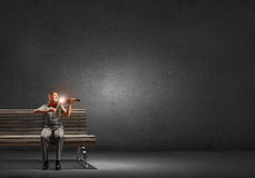 Man play violin. Young handsome man sitting on bench and playing violin Royalty Free Stock Photography