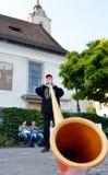Man played alp horn on the street of Luzern Stock Photo