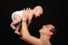 Man playfully lifting son  Royalty Free Stock Photos