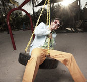 Man on a playground Stock Images