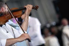 Man playin the violin. Man playing violin, live show at a wedding party Royalty Free Stock Photography
