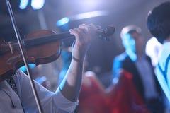 Man playin the violin. Man playing violin, live show at a wedding party Stock Photos