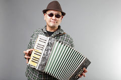 Man playing accordion Stock Images