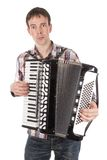 Man playing an accordion isolated over white Stock Photos
