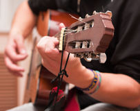 Man playing an accoustic guitar Stock Images