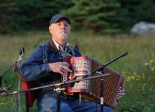 Man Playing Acordian Outdoors Royalty Free Stock Photography
