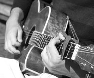 Man playing acoustic guitar. Close up black and white of man playing an acoustic guitar Stock Images