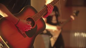A man playing acoustic guitar - a band performance in the club. Mid shot stock video