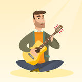 Man playing the acoustic guitar. Stock Image
