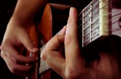 Man playing acoustic guitar Stock Photos