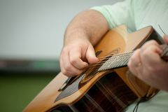 Acoustic guitar being played by a man royalty free stock photography