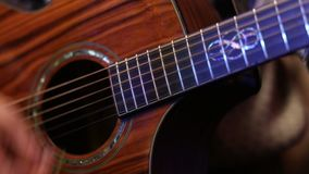 Man playing acoustic guitar close up stock video