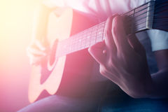 Man playing acoustic guitar in concert Royalty Free Stock Image