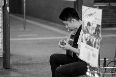 Man Playing Acoustic Guitar Grayscale Photography stock photo