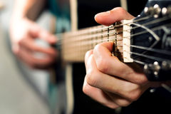 Man playing on the acoustic guitar Stock Photos