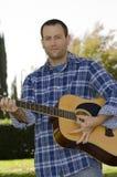 Man playing acoustic guitar Royalty Free Stock Image