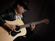 Man playing acoustic guitar at rock concert Royalty Free Stock Photo