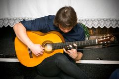 Man playing acoustic guitar. A man playing acoustic guitar on stage Stock Image