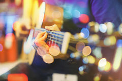 Man playing an acoustic guitar on stage. Stock Images