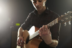 Man Playing Acoustic Guitar In Studio Royalty Free Stock Photography