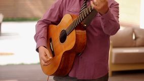Man playing acoustic guitar Ukraine stock footage