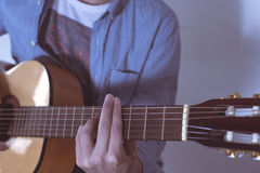 Man playing acoustic guitar Royalty Free Stock Photography