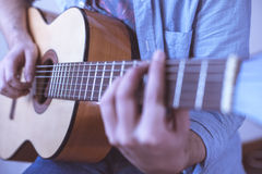 Man playing acoustic guitar royalty free stock images