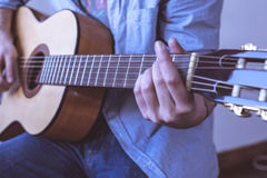Man playing acoustic guitar. On a white background Stock Photos