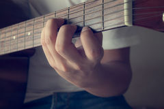 Man in playing acoustic guitar Royalty Free Stock Photo