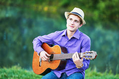 Man playing acoustic six string guitar Royalty Free Stock Images