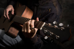 Man playing acoustics guitar Stock Photos