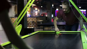 Man playing air hockey game. Young man playing air hockey game stock video