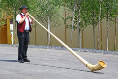 Man playing alphorn in Expo 2015, Milan Royalty Free Stock Photos