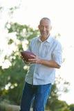 Man playing american football Stock Photo