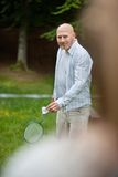 Man Playing Badminton In Park Stock Image