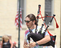 Man playing bagpipes closeup in a parade in small town America Royalty Free Stock Photo