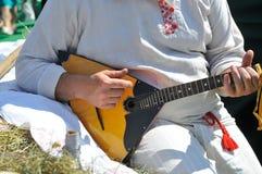 Man playing the balalaika. Man playing the russian balalaika Royalty Free Stock Photo