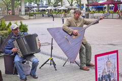 A man playing a balalaika in a Luxembourg square Stock Image