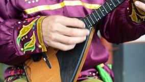 Man playing balalaika. stock video