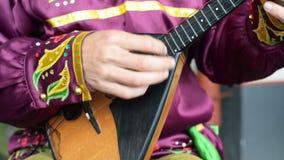 Man playing balalaika. stock video
