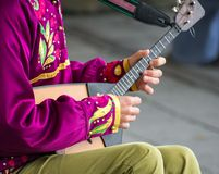 Man playing balalaika. Stock Images