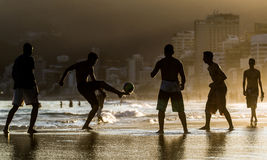 Man playing with ball at beach royalty free stock images