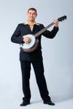 Man Is Playing on Banjo. Royalty Free Stock Photos