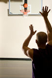 Man playing basketball Stock Image