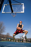 Man Playing Basketball. A young basketball player driving to the hoop Royalty Free Stock Photography