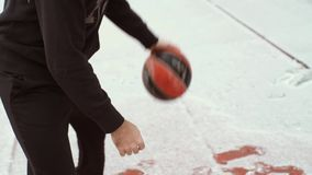 Man playing basketball at winter outdoors stock footage