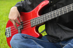 Man playing the bass guitar Stock Photography